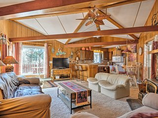 The living area is highlighted by vaulted ceilings & exposed wood beams.