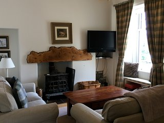 Sitting room , with wood burning stove.