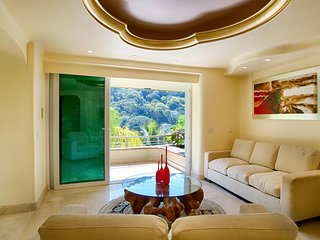 Garden, beach, ocean and tropical forest views from a Luxury suite