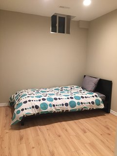 Newly renovated basement bedroom with twin bed