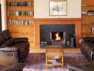 The open fire is always a delight in the sitting room