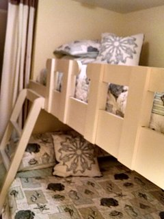 Twin Bunk over a full size bunk with premium mattresses and bedding. Ensuite with shower