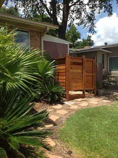 Outdoor, enclosed shower with hot/cold running water. Great for rinsing off!