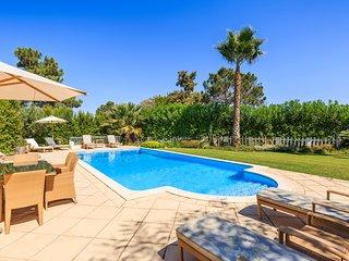 Luxury villa in Quinta do Lago with indoor & outdoor pools, short walk to Lake.