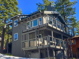 Mountain home has views of Lake Tahoe and 3 decks! PRIVATE HOT TUB on the 1st floor deck shown here.