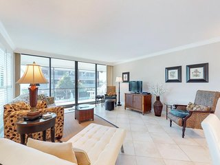 Modern condo by the beach w/ shared pool, furnished balcony & partial Gulf views