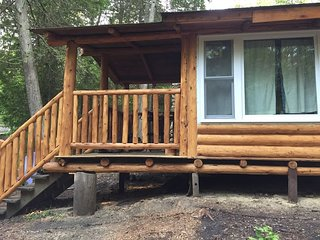 Log cabin in the north woods...Lake Michigan beach...open May 25 to October 10