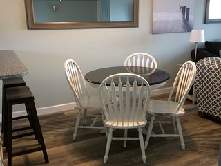 Dining area: table for four, breakfast bar for two
