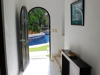 The beautiful pool is right by the front door, with the secluded garden at the back