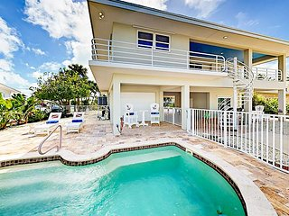4BR Tropical Retreat w/ Guest Suite, Waterfront Yard, Private Dock & Pool