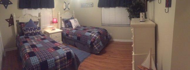 2 TWIN BEDS IN THIRD BEDROOM WITH RALPH LAUREN COMFORTER SET. HDTV/DVD PLAYER, ALARM CLOCK, STORAGE