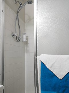 The shower in the basement apartment