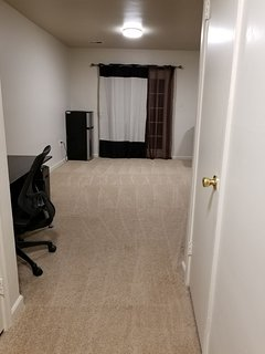 The living room in the basement apartment