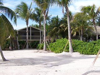 Private beach estate.  Gated, tropical peace and quiet.  Dock.