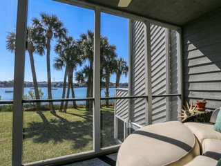 Relax in the sun at this riverside condo!