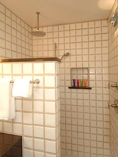 Enjoy the rain shower of Mexican tile accented by 'Tobacco' granite.