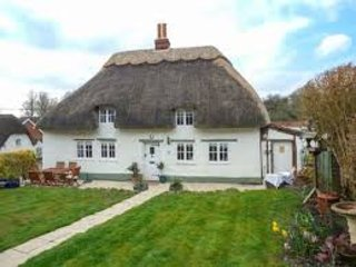 17th  Century Thatched Cottage in quaint Wiltshire village