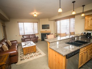 Open living area with full kitchen and easy pool access