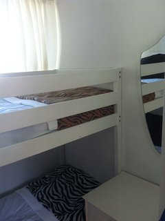 Bunk beds both with new foam mattress