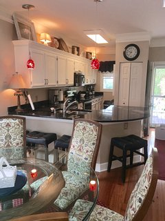 Kitchen area with granite countertops, washer/dryer, new appliances