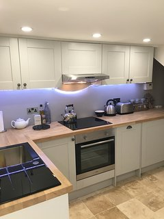 Kitchen which includes dishwasher, washing machine, microwave, fridge freezer and all you need.