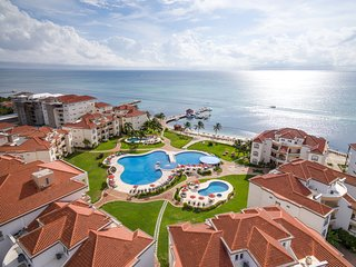 Wake up OCEANFRONT!!! NEW 2 BED/2.5 BATH or 1 BED/1.5 BATH Condo at Grand Caribe
