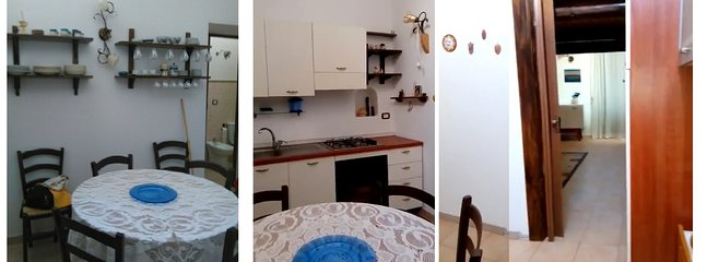 kitchen, furnished, equipped with dishes, refrigerator and freezer.
