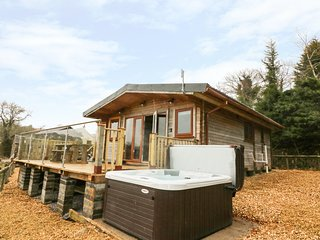 THE CABIN, open-plan living, decking with hot tub, countryside valley views