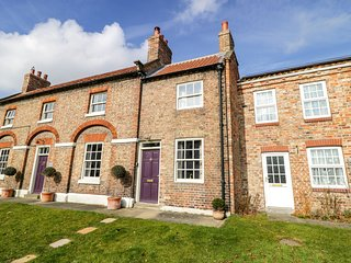 CHAPEL COTTAGE, period stone cottage, open fire, enclosed courtyard, in York, Re