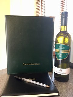 Welcome bottle of wine & Information Book