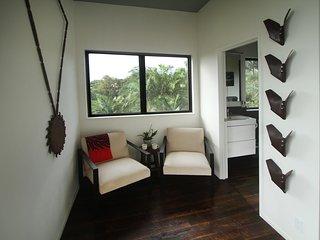 Ocean-Cacao Room seating area w/ Farm influenced artwork.