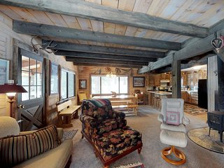 Woodland cabin w/ screened porch & meadow views - near town, golf & the lake!
