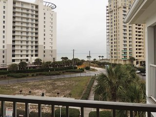 Oceanview condo with shared pool only a few moments away from the beach!