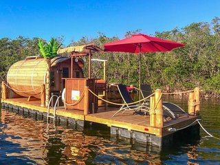 Eco-friendly floating cabin & deck w/ dinghy, tiki bar, grill & lounge chairs!