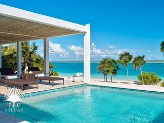 Experience the Turquoise Views of Turks and Caicos at Stunning 4BR Villa