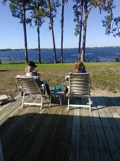 Guests enjoying a beautiful day out on the deck.
