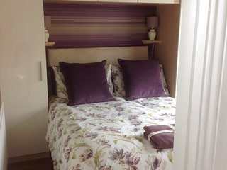 Cosy bedroom with double bed, memory foam mattress and topper.