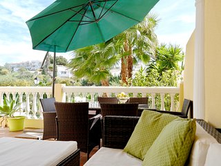 A cosy apartment with big terrace and pool just a step out in the garden