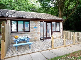 Beach hut themed self cartering bungalow set in 100 acres of woodland.
