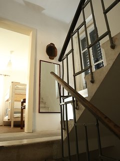 stairs and view of triple room on the second floor