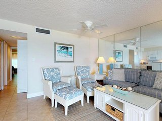 Gulfront getaway with sweeping views, shared pool, and easy beach access