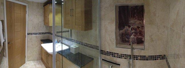 Panoramic view of bathroom.