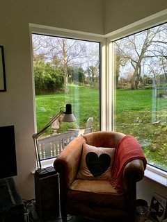 The corner window in the living area with beautiful garden views