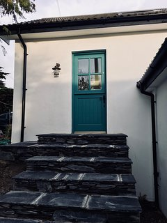 The steps up to Foxglove Cottage which is accessed along a lane way from the street