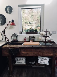 An old woodworking bench is given a new lease of life for the sink!