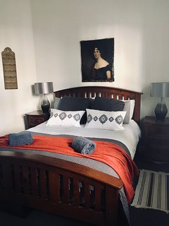 Spacious master bedroom with super comfy king size bed