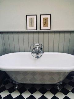 Free-standing bath...you'll enjoy a soak in here!
