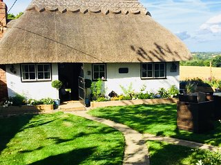 Detached Thatched Cottage sleeps 4-8 in a True Idyllic setting with own Hot Tub