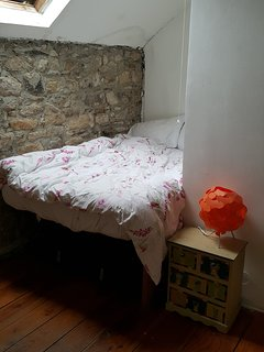 Our 2nd bedroom is a cosy sleeping nook tucked under the eaves with skylight to the stars and moon.