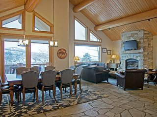 Massive Great Room with 20+ foot high vaulted ceilings and amazing views